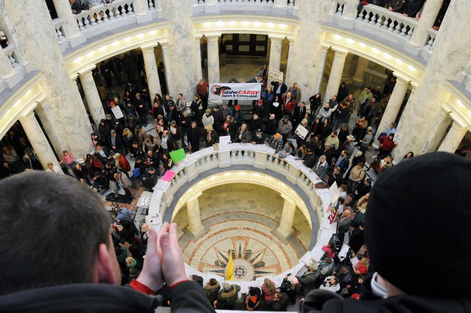 Pro-gun supporters attend a rally inside the Idaho Statehouse on Saturday, Jan. 19, 2013 in Boise.  Rallies are being held by gun rights advocates four days after President Barack Obama unveiled a sweeping plan to curb gun violence.  (AP Photo/Idaho Press-Tribune, Adam Eschbach) MANDATORY CREDIT