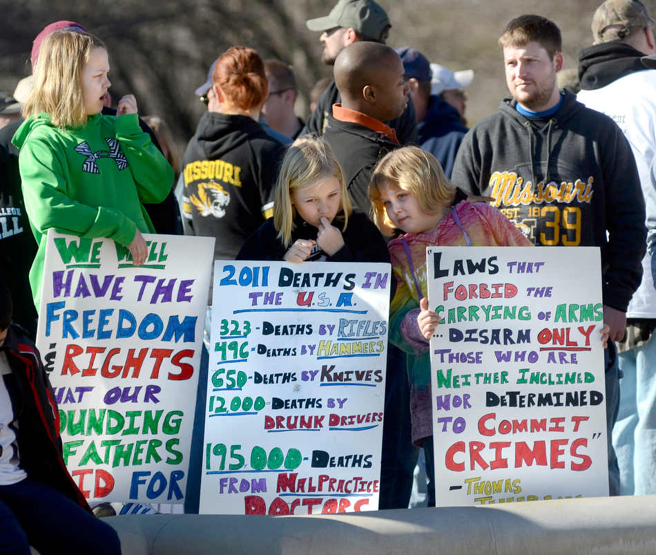 From left, friends Ella Sikes,10, Macey Seabaugh, 9, and Zoe Sikes, 7, from Fredericktown, Mo. each hold signs they made for a gun rights rally outside the capitol building in Jefferson City, Mo. on Saturday, Jan. 19, 2013. Second Amendment advocates rallied in state capitals nationwide Saturday, days after President Barack Obama unveiled a sweeping package of federal gun-control proposals. (AP Photo/The Jefferson City News-Tribune)
