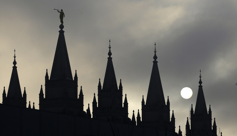 The Salt Lake Temple in Temple Square is silhouetted against the cloud-covered sky Wednesday, Feb. 6, 2013, in Salt Lake City.  (AP Photo/Rick Bowmer)