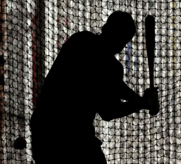 Kansas City Royals' Alex Gordon is silhouetted as he bats during a spring training baseball workout Tuesday, Feb. 12, 2013, in Surprise, Ariz. (AP Photo/Charlie Riedel)