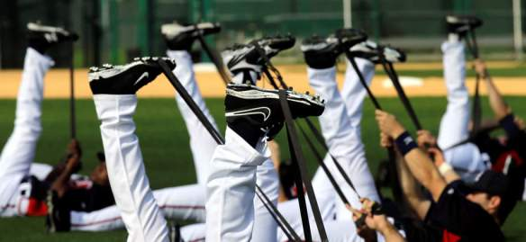 Atlanta Braves pitchers and catchers stretch during a spring training baseball workout Tuesday, Feb. 12, 2013, in Kissimmee, Fla. (AP Photo/David J. Phillip)