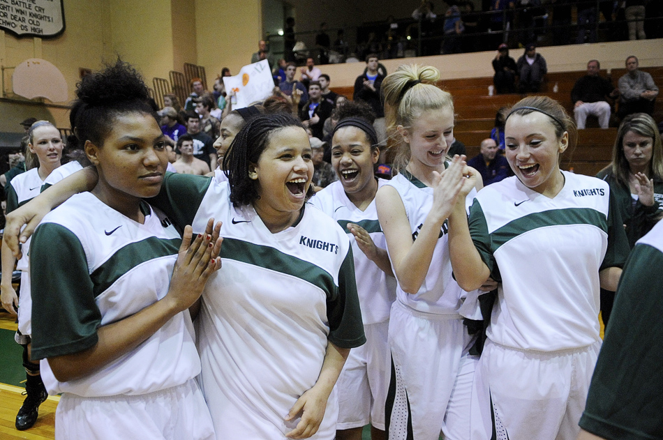 NICK SCHNELLE/JOURNAL STAR  Richwoods players celebrate after defeating United Township, 57-42, on Friday at a Class 4A Regional Championship game at Richwoods High School.