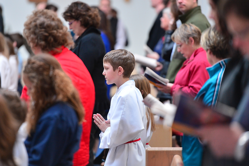 FRED ZWICKY/JOURNAL STAR Students from St. Thomas the Apostle Catholic School join other parishioners at St. Thomas the Apostle Catholic Church in Peoria Heights for Ash Wednesday services over the noon hour. The event marks the first day of Lenten season.