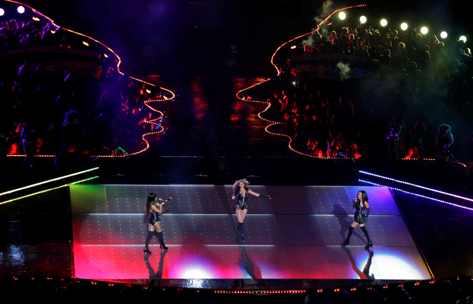Beyonce, center, and other members of Destiny's Child, Kelly Rowland, left, and Michelle Williams perform during the halftime show of the NFL Super Bowl XLVII football game Sunday, Feb. 3, 2013, in New Orleans. (AP Photo/Charlie Riedel)