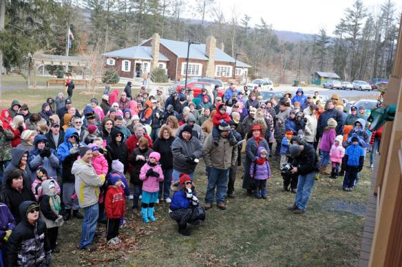 A crowd listens after Pine Grove Grundsau Lodge No. 5 stuffed Groundhog Grover and his bride Sweet Arrow Sue predicted six more weeks of winter during the annual Groundhog Day Celebration in Pine Grove, Pa., Saturday, Feb. 2, 2013. (AP Photo/The Republican-Herald, Jacqueline Dormer)