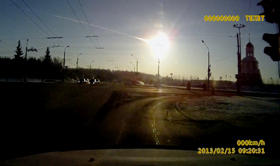 In this frame grab made from a video done with a dashboard camera a meteor streaks through the sky over Chelyabinsk, about 1500 kilometers (930 miles) east of Moscow,  Friday, Feb. 15, 2013. A meteor that scientists estimate weighed 10 tons (11 tons) streaked at supersonic speed over Russia's Ural Mountains on Friday, setting off blasts that injured some 1000 people and frightened countless more. (AP Photo/AP Video)