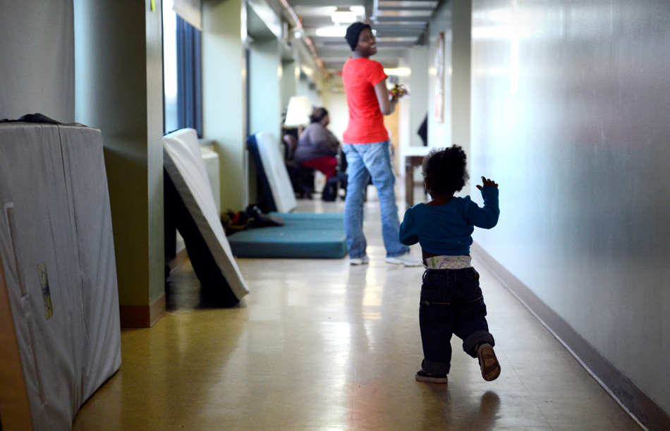 DAVID ZALAZNIK/JOURNAL STAR  Ni'ayla Ateman runs to catch her mother, Samantha Williams, 21, after spending the night in the emergency homeless shelter at Peoria Dream Center.