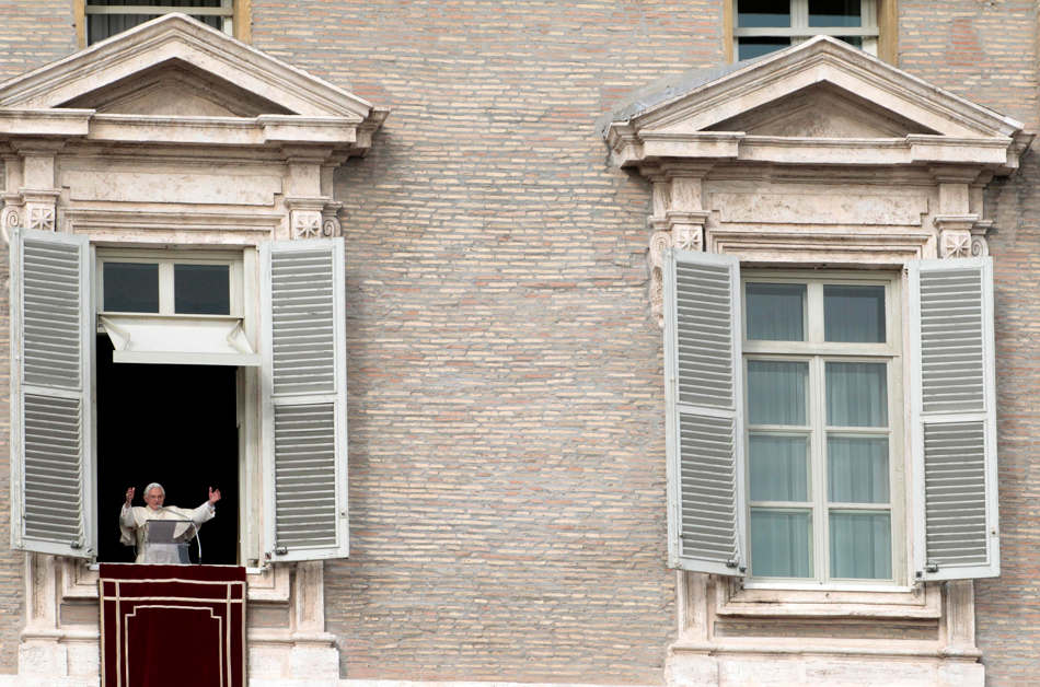 Pope Benedict XVI waves to faithful during the Angelus prayer he delivered from his studio window overlooking St. Peter's square at the Vatican, Sunday, Dec. 2, 2012. (AP Photo/Gregorio Borgia)