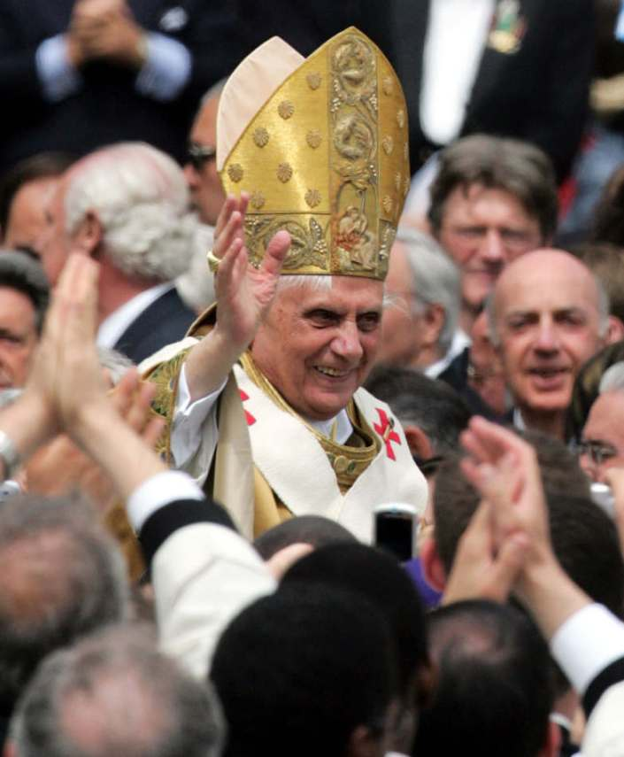 FILE - In this Sunday, Sunday, April 24, 2005 file photo, Pope Benedict XVI waves as he rides on the Popemobile through St. Peter's Square at the Vatican, following his installment Mass. Pope Benedict XVI announced Monday, Feb. 11, 2013, he would resign Feb. 28 because he is simply too old to carry on. (AP Photo/Andrew Medichini, File)