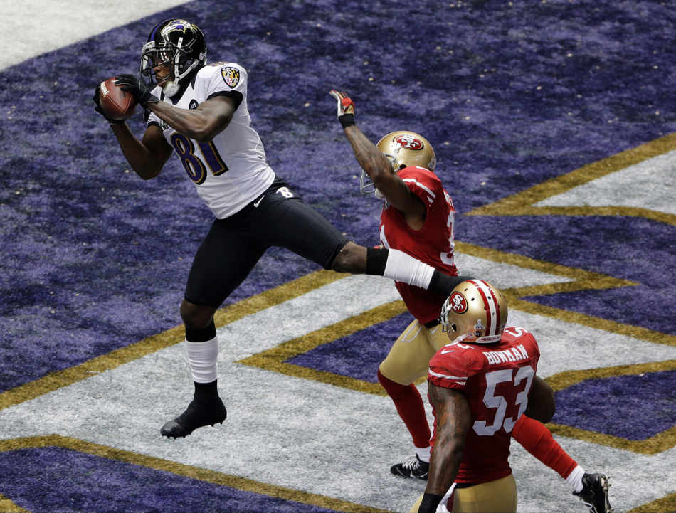 Baltimore Ravens wide receiver Anquan Boldin (81) catches a 13-yard pass for a touchdown as San Francisco 49ers linebacker NaVorro Bowman (53) trails the play during the first half of the NFL Super Bowl XLVII football game, Sunday, Feb. 3, 2013, in New Orleans. (AP Photo/Charlie Riedel)