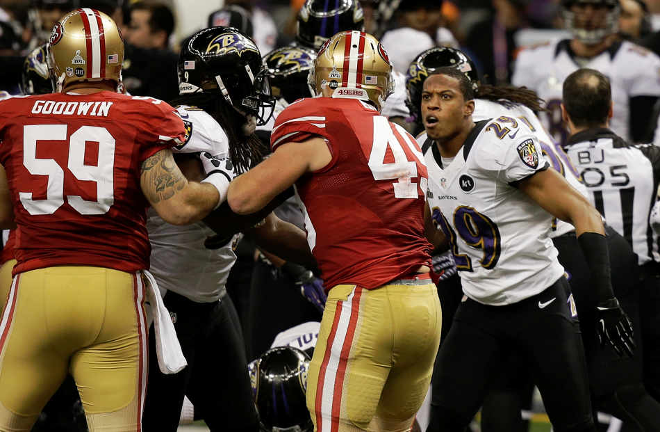 Baltimore Ravens cornerback Cary Williams (29) argues with San Francisco 49ers guard Jonathan Goodwin (59) and fullback Bruce Miller (49) during the first half of the NFL Super Bowl XLVII football game Sunday, Feb. 3, 2013, in New Orleans. (AP Photo/Gene Puskar)