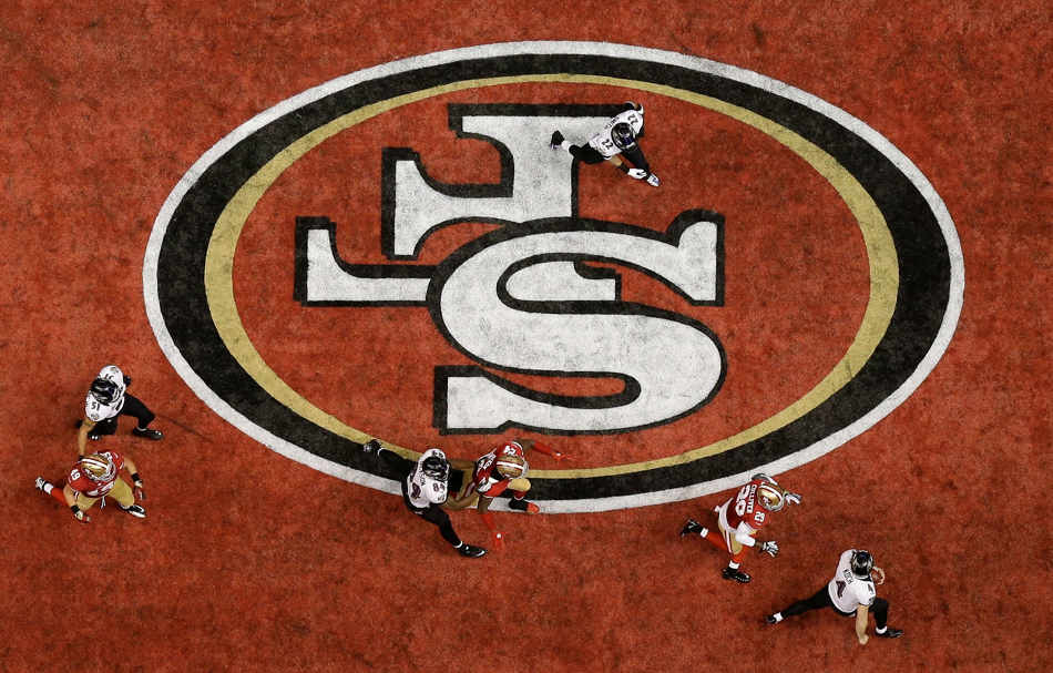 Baltimore Ravens punter Sam Koch (4) runs out of the end zone for a safety during the second half of the NFL Super Bowl XLVII football game against the San Francisco 49ers Sunday, Feb. 3, 2013, in New Orleans. (AP Photo/David J. Phillip)