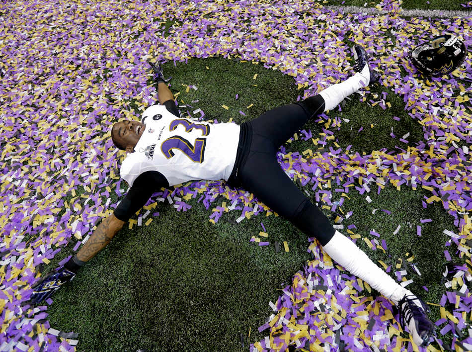 Baltimore Ravens defensive back Chykie Brown (23) lays in the confetti after defeating the San Francisco 49ers 34-31 in the NFL Super Bowl XLVII football game, Sunday, Feb. 3, 2013, in New Orleans. (AP Photo/Marcio Sanchez)