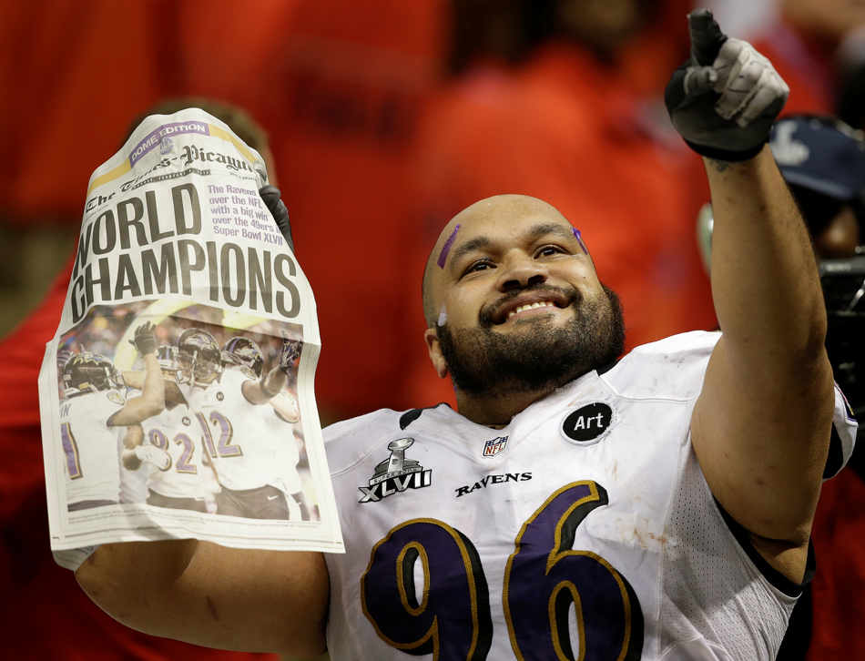 Baltimore Ravens nose tackle Ma'ake Kemoeatu (96) celebrates after defeating the San Francisco 49ers 34-31 in the NFL Super Bowl XLVII football game, Sunday, Feb. 3, 2013, in New Orleans. (AP Photo/Elaine Thompson)