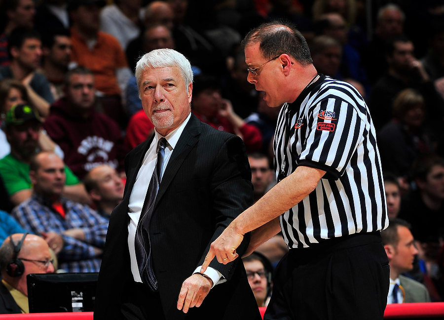 FRED ZWICKY/JOURNAL STAR In a contentious first half, Harrisburg head coach Randy Smithpeters is told to step back by the officials as Seton plays Harrisburg in the Class 2A title game Saturday night at the Peoria Civic Center.