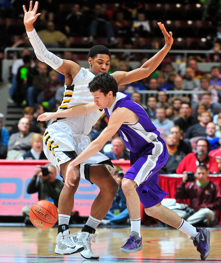 FRED ZWICKY/JOURNAL STAR Seton Alex Foster tries to stop Harrisburg's Harrisburg's Tyler Smithpeters in the Class 2A title game Saturday night at the Peoria Civic Center.