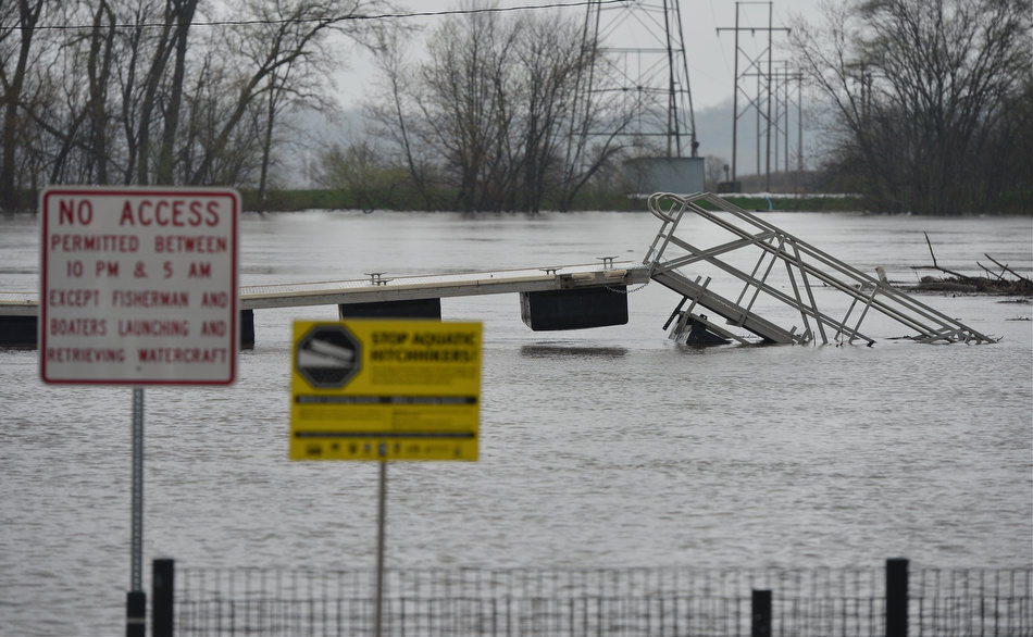 FRED ZWICKY/JOURNAL STAR The Illinois River claims large sections of Pekin Riverfront Park in downtown Pekin as flood waters cover the walkways and boat docks Tuesday.