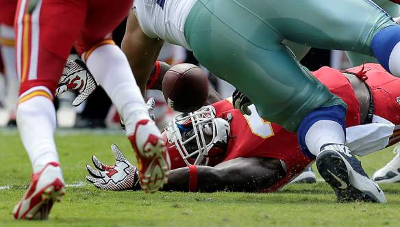 Kansas City Chiefs defensive back Ron Parker (38) grabs a fumble by Dallas Cowboys quarterback Tony Romo (9) during the second half of an NFL football game at Arrowhead Stadium in Kansas City, Mo., Sunday, Sept. 15, 2013. (AP Photo/Charlie Riedel)