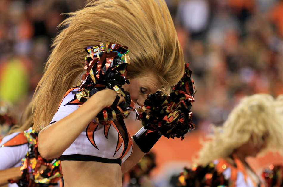 A Cincinnati Bengals cheerleader performs during the second half of an NFL football game against the Pittsburgh Steelers, Monday, Sept. 16, 2013, in Cincinnati. (AP Photo/Tom Uhlman)