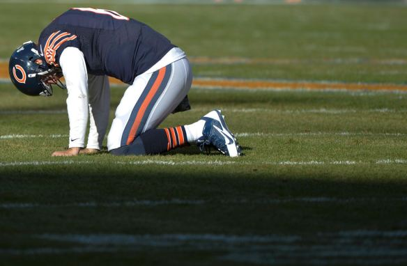 RON JOHNSON/JOURNAL STAR  Chicago Bears quarterback Jay Cutler kneels on the field after injuring his angle during Sunday's game with the Detroit Lions.