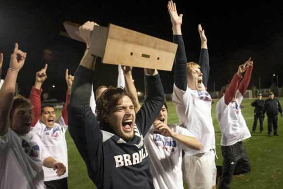 JUSTIN WAN/JOURNAL STAR Bradley players, including goalkeeper Brian Billings, center, celebrate after winning the Missouri Valley Conference men's soccer championship game on Nov. 17 at Shea Stadium. Bradley defeated Missouri State, 1-0.