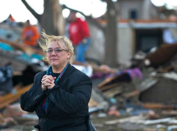 RON JOHNSON/JOURNAL STAR  A Washington resident looks over the devastation created by a tornado that destroyed her home on Nov. 17.
