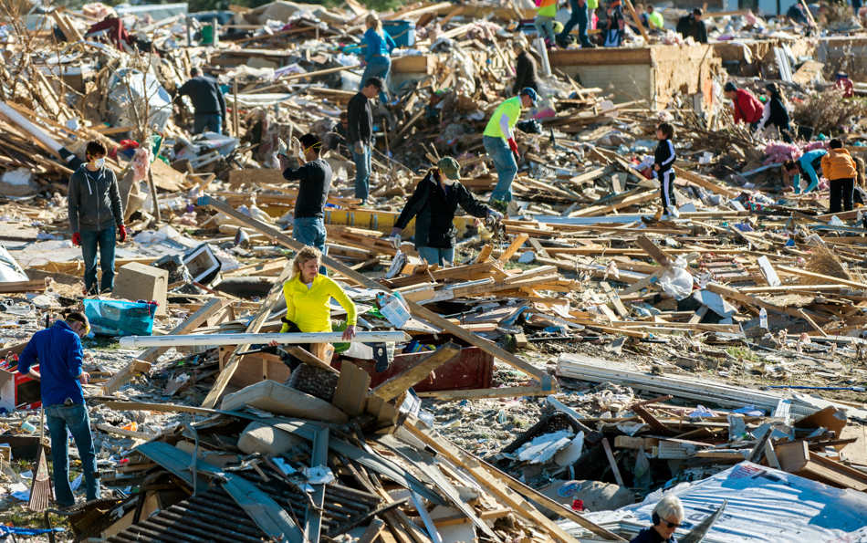 FRED ZWICKY/JOURNAL STAR Homeowners and helpers dig out what they can from a mountain of debris on Nov. 19 after more than 1,000 homes were devastated  by an EF4 tornado that passed through Washington on Nov. 17.