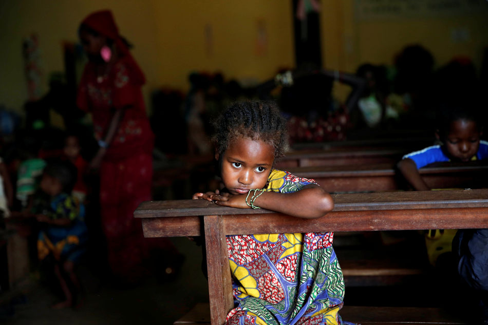 A Muslim child sits inside the St. Pierre church where she and hundreds of other Muslims are seeking refuge in Boali, Central African Republic, some 80kms (50 miles) north-west of Bangui, Thursday, Jan. 23,  2014. Clashes erupted between Anti-Balaka Christians and Seleka militias as thousands of Muslims try to flee the looting of their neighborhoods, on the day of the inauguration of Central African Republic's interim President Catherine Samba-Panza. (AP Photo/Jerome Delay)