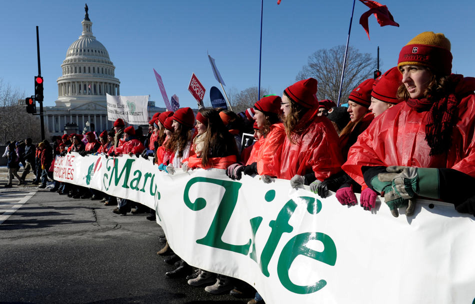 Protestor lead the annual March for Life Rally near Capitol Hill and the Supreme Court in Washington, Wednesday, Jan. 22, 2014. Thousands of abortion opponents are facing wind chills in the single digits to rally and march on Capitol Hill to protest legalized abortion, with a signal of support from Pope Francis. (AP Photo/Susan Walsh)