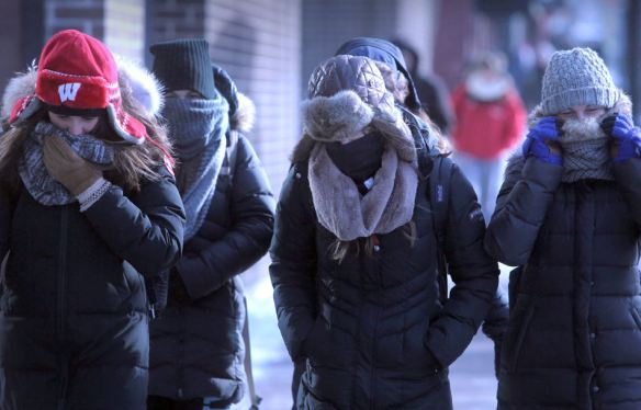 Pedestrians making their way along State Street are well-bundled against the region's return to bitterly cold conditions, Monday, Jan. 27, 2014, in Madison, Wis. (AP Photo/Wisconsin State Journal, John Hart)