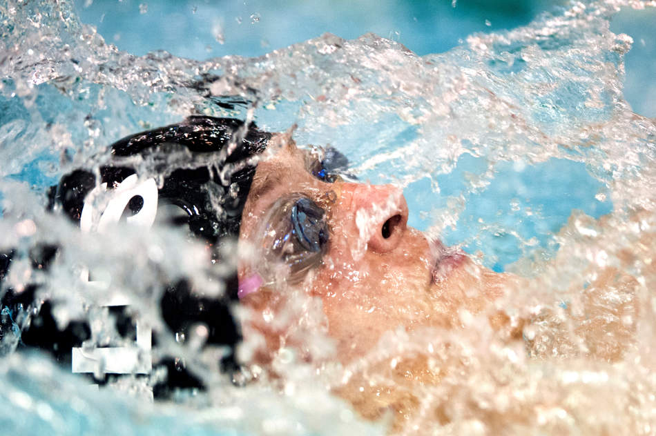 JUSTIN WAN/JOURNAL STAR Dunlap's Jared Tyre swims in the boys 100-meter backstroke event on Dec. 21 during the 2013 Richwoods Midwest Invitational.