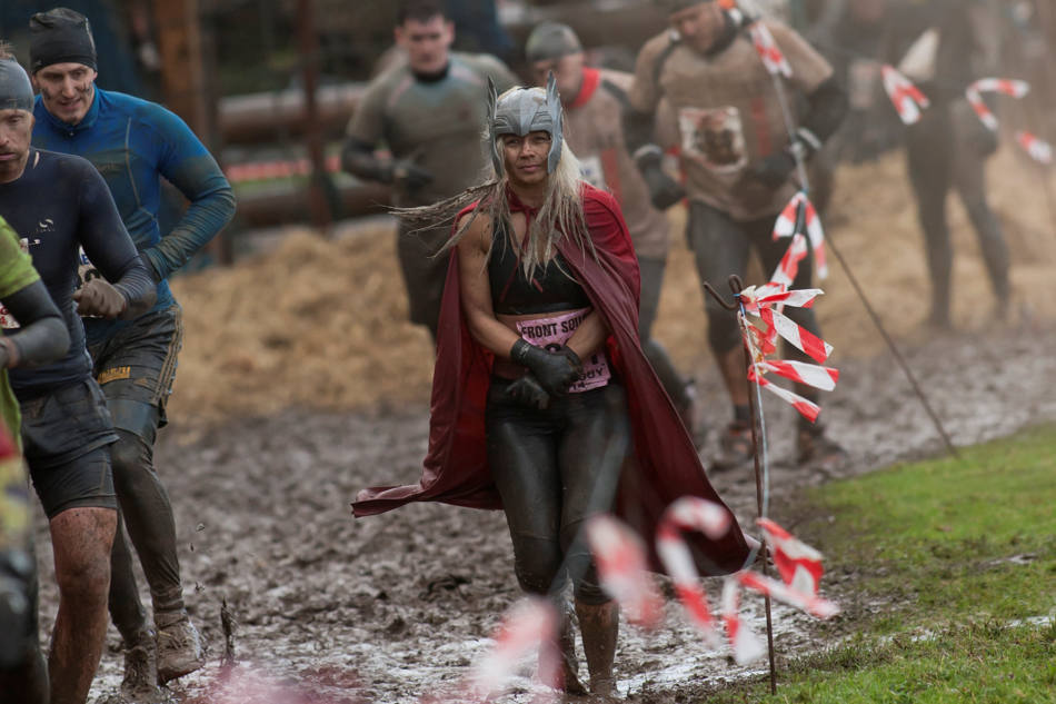 "Competitors make their way across an obstacle during the annual Tough Guy race ""the toughest race in the world"" at Perton in Staffordshire, England, Sunday Jan. 26, 2014. Tough Guy claims to be the world's most demanding one-day survival ordeal. First staged in 1987, the Tough Guy Challenge has been widely described as one of the hardest races of it's type with up to one-third of the starters failing to finish in a typical year. (AP Photo/Jon Super)"