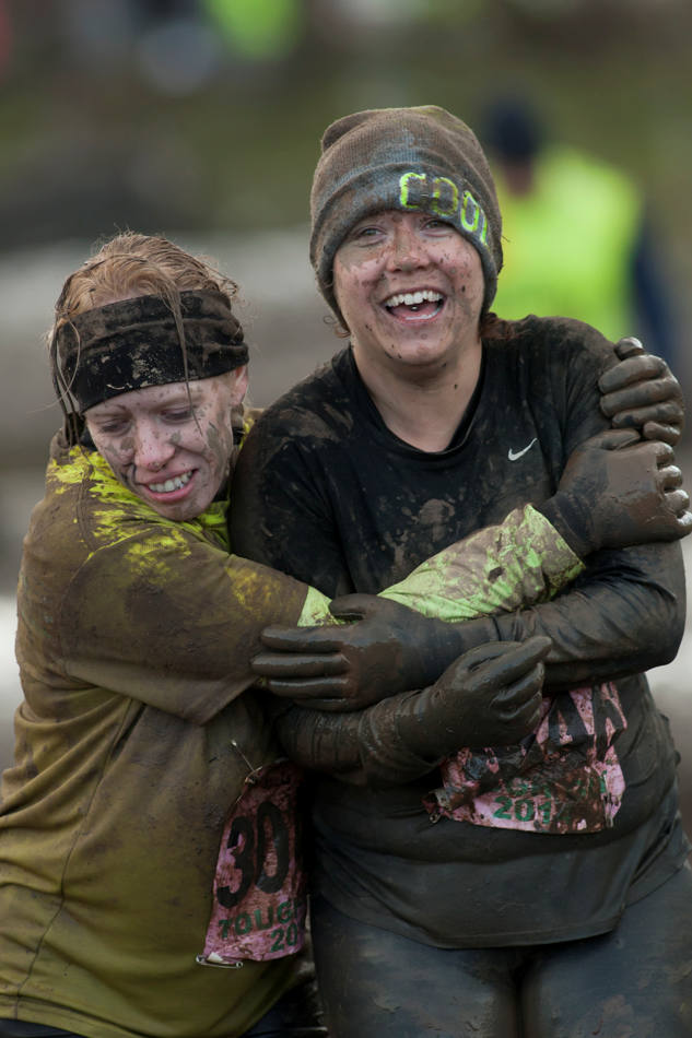 "Competitors helps each other during the annual Tough Guy race ""the toughest race in the world"" at Perton in Staffordshire, England, Sunday Jan. 26, 2014. Tough Guy claims to be the world's most demanding one-day survival ordeal. First staged in 1987, the Tough Guy Challenge has been widely described as one of the hardest races of it's type with up to one-third of the starters failing to finish in a typical year. (AP Photo/Jon Super)"