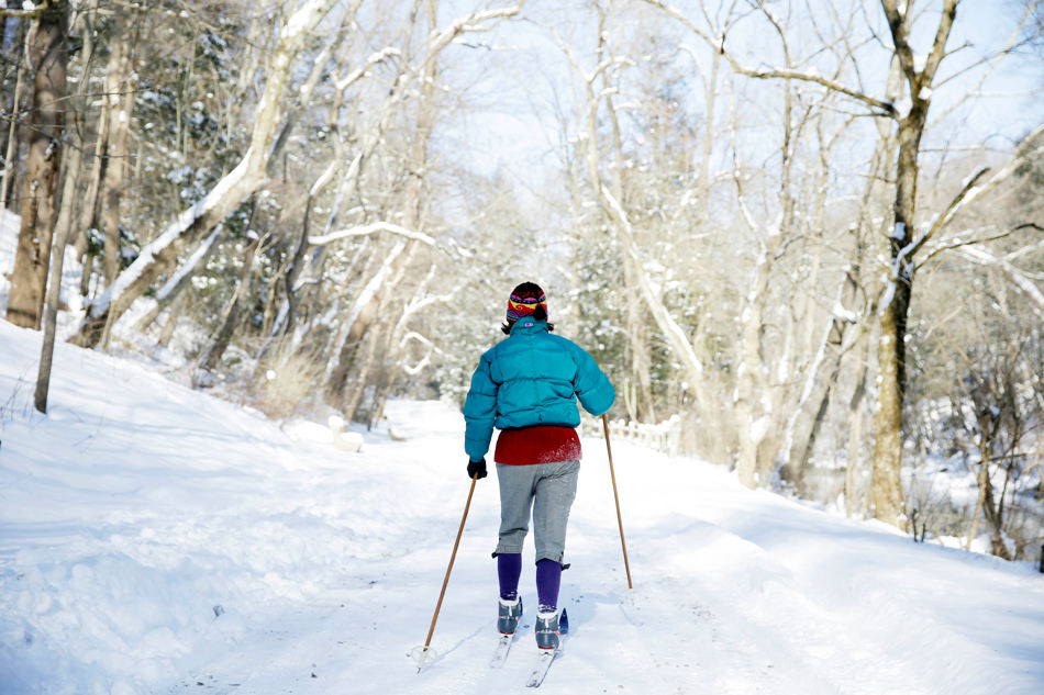 A women skis in recently fallen snow Wednesday, Jan. 22, 2014, at the Wissahickon Valley Park  in Philadelphia.  A winter storm stretched from Kentucky to New England and hit hardest along the heavily populated Interstate 95 corridor between Philadelphia and Boston.  (AP Photo/Matt Rourke)