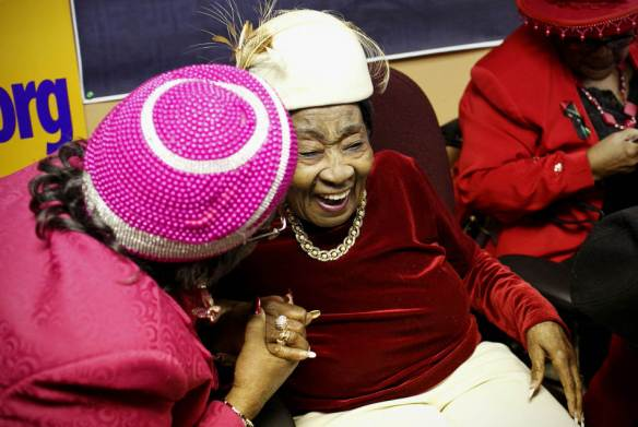 KRISTEN ZEIS/JOURNAL STAR Imogene Jackson, left, hugs and congratulates longtime friend Pearly M. Bonds at a dedication ceremony for the Pearly M. Bonds Community Center on January 26 in Peoria. The ceremony was held to honor Bonds for her hard work and dedication to the community.