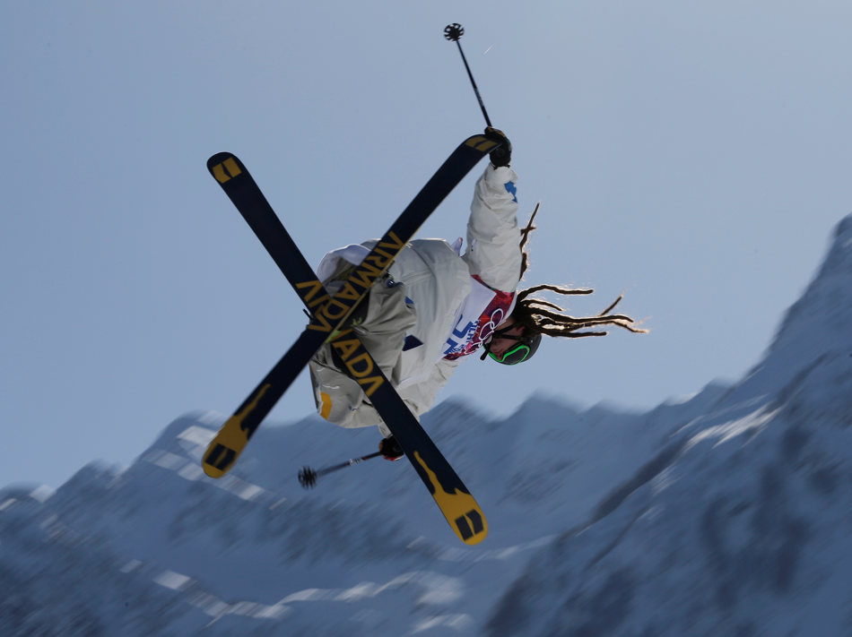 Sweden's Henrik Harlaut takes a jump during a ski slopestyle training session at the Rosa Khutor Extreme Park, prior to the 2014 Winter Olympics, Tuesday, Feb. 4, 2014, in Krasnaya Polyana, Russia. (AP Photo/Andy Wong)