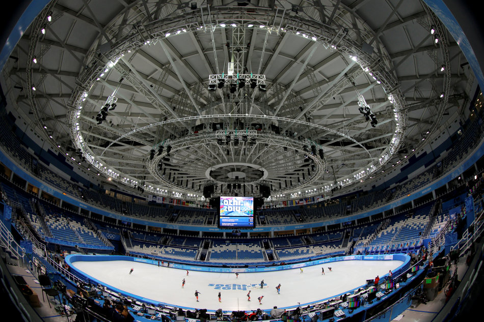 In this photo taken with a fisheye lens, short track speed skating teams from Ukraine, Hong Kong, Canada and Taiwan attend a training session at the Iceberg Skating Palace ahead of the 2014 Winter Olympics, Tuesday, Feb. 4, 2014, in Sochi, Russia. (AP Photo/Vadim Ghirda)