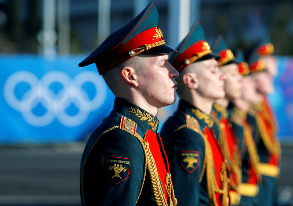 Russian soldiers stand during the welcome ceremony for the Philippine Olympic team in the Athletes Village at Olympic Park ahead of the 2014 Winter Olympics in Sochi, Russia, Sunday, Feb. 2, 2014. The games run from Feb. 7-23.  (AP Photo/Alexander Demianchuk, Pool)