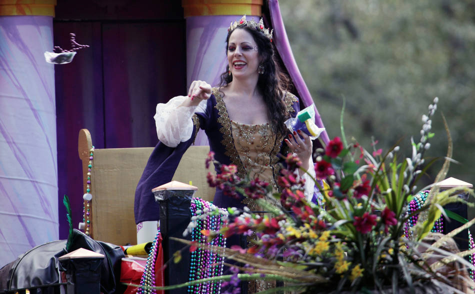 The Queen of the Tucks Mardi Gras parade marches through the streets of New Orleans, Saturday, March 1, 2014. This is the last full weekend of the Mardi Gras season which will end on Tuesday. (AP Photo/Bill Haber)