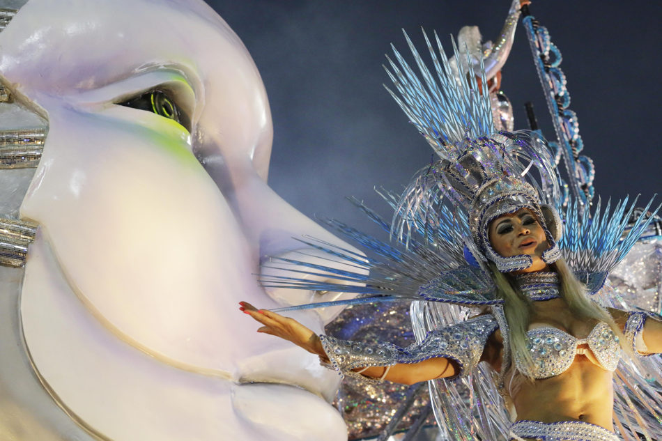 A performer from the Beija Flor samba school parades during carnival celebrations at the Sambadrome in Rio de Janeiro, Brazil, Monday, March 3, 2014. (AP Photo/Nelson Antoine)