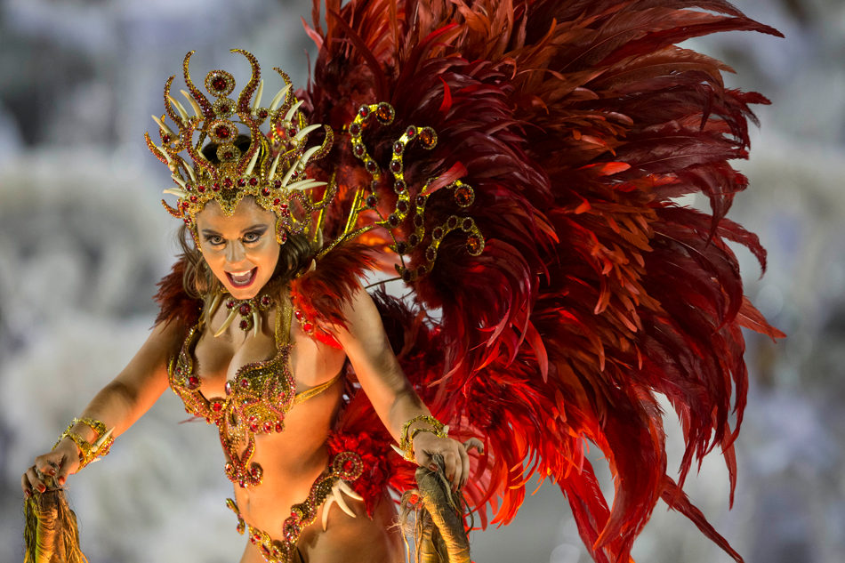 A performer from the Imperio da Tijuca samba school parades on a float during carnival celebrations at the Sambadrome in Rio de Janeiro, Brazil, Sunday, March 2, 2014. (AP Photo/Felipe Dana)