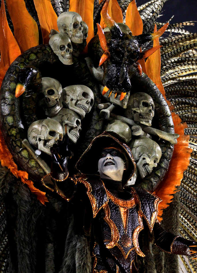 Performer from the Salgueiro samba school parades during carnival celebrations at the Sambadrome in Rio de Janeiro, Brazil, Monday, March 3, 2014. (AP Photo/Silvia Izquierdo)