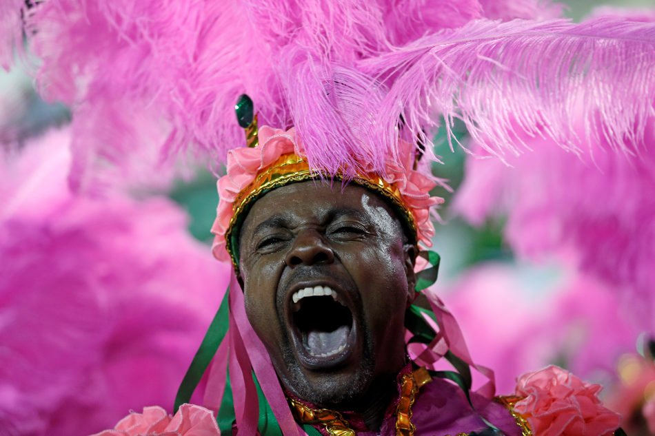 A performer from the Mangueira samba school parades during carnival celebrations at the Sambadrome in Rio de Janeiro, Brazil, Monday, March 3, 2014. (AP Photo/Silvia Izquierdo)
