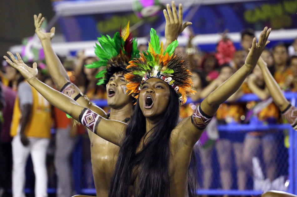 Performers from the Mangueira samba school parade during carnival celebrations at the Sambadrome in Rio de Janeiro, Brazil, Monday, March 3, 2014. (AP Photo/Nelson Antoine)