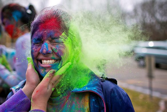 KRISTEN ZEIS/JOURNAL STAR Komal Bhardwaj, 17, of Peoria has colored powder thrown on her by Aushi Kumar, 16, of Dunlap at a Holi celebration Sunday, March 16   at the Hindu Temple of Central Illinois. Holi, also called the Festival of Colors, is an ancient Hindu festival that symbolizes victory over evil, communicates strength of love and faith, as well as the welcoming of Spring.