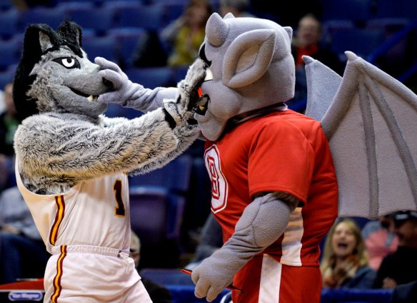 RON JOHNSON/JOURNAL STAR   LU Wolf, left, the Loyola mascot, and Kaboom, the gargoyle mascot of Bradley,face off Thursday, March 6 during the play-in round of the Missouri Valley Conference Tournament in St. Louis.