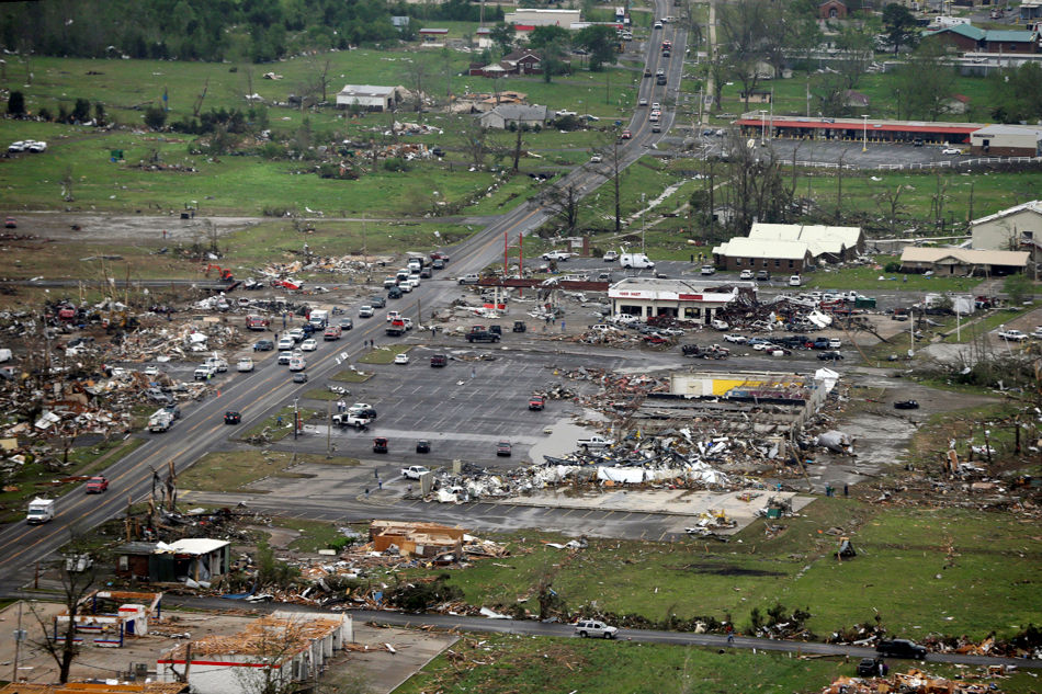 In this aerial photo, destroyed businesses along U.S. Highway 64 sit among rubble in Vilonia, Ark., Monday, April 28, 2014. A tornado struck the town late Sunday. Vilonia was hit hard Sunday for the second time in three years. Four people were killed in a 2011 storm. (AP Photo/Danny Johnston)