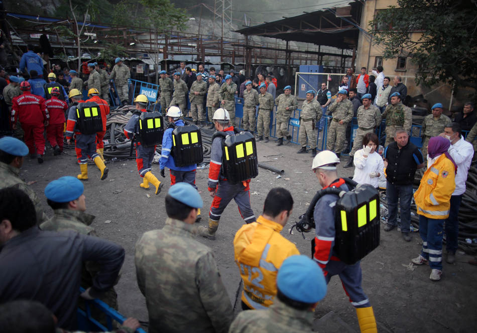 Rescue workers arrive to get into the mine in Soma, western Turkey, early Wednesday, May 14, 2014. Rescuers desperately raced against time to reach more than 200 miners trapped underground Wednesday after an explosion and fire at a coal mine in western Turkey killed at least 205 workers, authorities said, in one of the worst mining disasters in Turkish history. Turkey's Energy Minister Taner Yildiz said 787 people were inside the coal mine in Soma, some 250 kilometers (155 miles) south of Istanbul, at the time of the accident and 363 of them had been rescued so far. (AP Photo/Emrah Gurel)