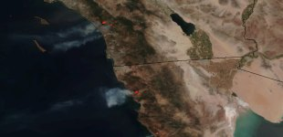 Wildfires tear through parts of Southern California