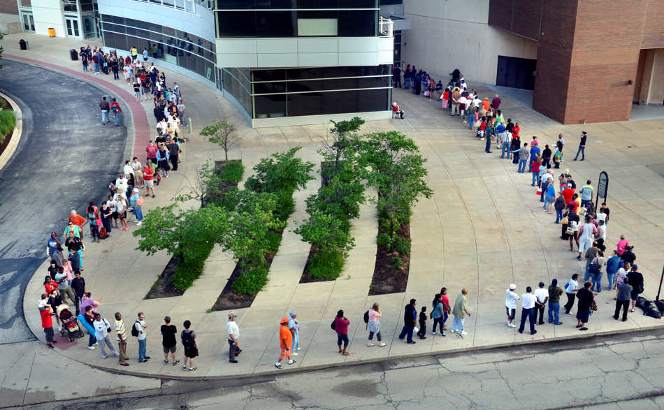DAVID ZALAZNIK/JOURNAL STAR  A line extends out of the door of the Peoria Civic Center shortly after the 6 a.m. opening Friday, June 20 of the Illinois Mission of Mercy free dental clinic.